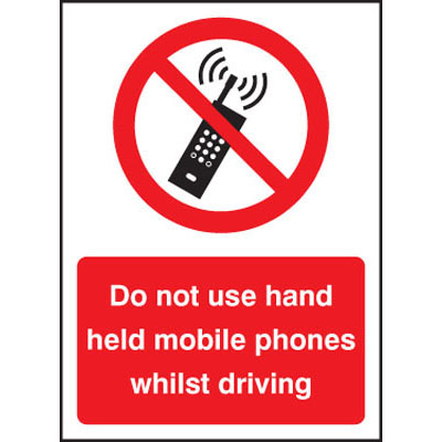 Do not use hand held mobile phones whilst driving sign